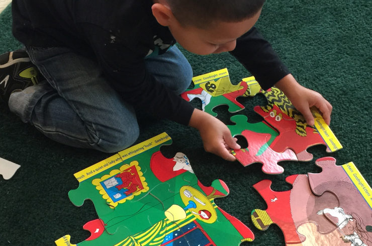 Child completing a puzzle